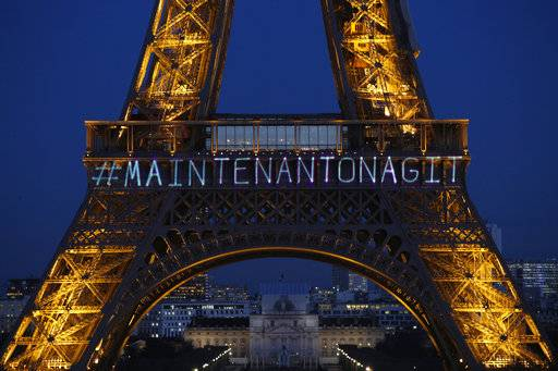 "The powerful message ""Maintenant On Agit"" (""Now We Act"") is projected on the Eiffel Tower on the eve of International Women's Day to honor women's rights and promote the French equivalent of the Time's Up movement in Paris, Wednesday, March 7, 2018. Launched by the Foundation of Women, the movement aims to raise funds for associations helping women pursue cases before justice, ""so that no woman ever again has to say #MeToo."""