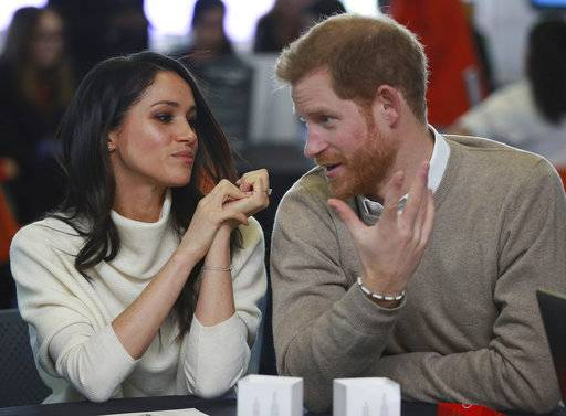 Britain's Prince Harry and Meghan Markle take part in an event as part of International Women's Day in Birmingham, central England, Thursday, March 8, 2018. (Ian Vogler/Pool via AP)