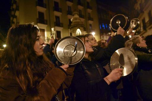 Demonstrators protest male violence against women and demand an equality labor opportunities during the general female strike to commemorate International Women's Day, in Pamplona, northern Spain, Thursday, March 8, 2018.