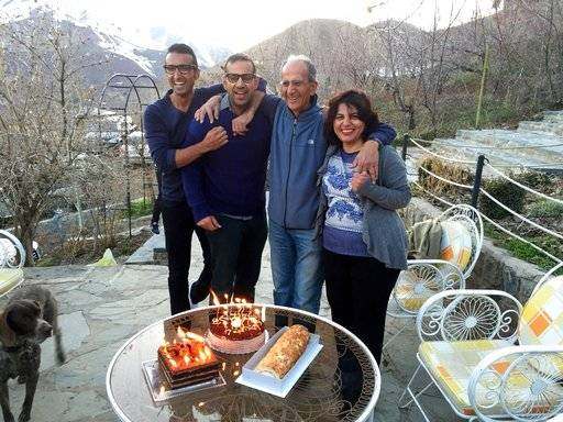This undated photo provided by the family of the late Iranian-Canadian professor Kavous Seyed-Emami, shows him, second right, and his wife, Maryam Mombeini, right, and their two sons in unidentified place in Iran. Canada's foreign affairs minister said Thursday, March 8, 2018, that Mombeini, the widow of Seyed-Emami, who died in custody in Tehran in disputed circumstances, has been stopped from leaving Iran. (Family of Kavous Seyed-Emami via AP)