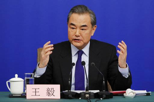 "China's Foreign Minister Wang Yi speaks during a press conference on the sidelines of the National People's Congress at the media center in Beijing, Thursday, March 8, 2018. China says its proposal for a ""dual suspension"" of North Korean nuclear tests in return for a halt to war games by South Korea and the U.S. has proven successful. Wang on Thursday told reporters that the suspension of such activities during the recent Winter Olympic Games in Pyeongchang, South Korea showed that China's approach ""was the right prescription for the problem and created basic conditions for the improvement of inter-Korean relations."""