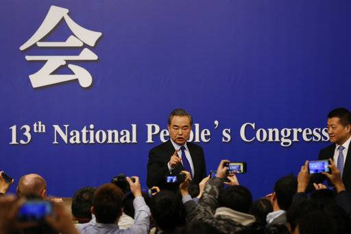 "China's Foreign Minister Wang Yi, center, gestures to journalists during a press conference on the sidelines of the National People's Congress at the media center in Beijing, Thursday, March 8, 2018. China says its proposal for a ""dual suspension"" of North Korean nuclear tests in return for a halt to war games by South Korea and the U.S. has proven successful. Wang on Thursday told reporters that the suspension of such activities during the recent Winter Olympic Games in Pyeongchang, South Korea showed that China's approach ""was the right prescription for the problem and created basic conditions for the improvement of inter-Korean relations."""