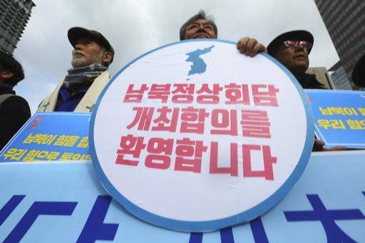 "Demonstrators stage a rally to support the planned two Koreas summit in Seoul, South Korea, Thursday, March 8, 2018. South Korea's president said Thursday that many ""critical moments"" still lie ahead to end the nuclear crisis despite North Korea's recent outreach to Seoul and Washington. The signs read "" Welcome to the planned two Koreas summit."""