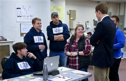 Democrat Conor Lamb, right, talks with some of his campaign volunteers at a campaign office in Carnegie, Pa., Wednesday, March 7, 2018. A special election in western Pennsylvania next week is shaping up as a test of the strength and loyalty of the modern-day labor movement. Lamb is running against Republican Rick Saccone in a special election being held on March 13 for the PA 18th Congressional District vacated by Republican Tim Murphy.