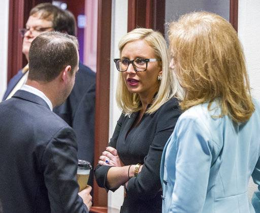 Florida Sen. Lauren Book (D-Plantation), center, speaks with Rep. Jared Even Moskowitz (D-Coral Springs), left, and Rep. Kristin Diane Jacobs (D-Coconut Creek) on the House floor during questioning on the school safety bill at the Florida Capital in Tallahassee, Fla., Tuesday March 6, 2018.
