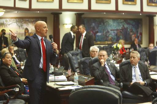 Rep, Joseph Abruzzo, D- Boyton Beach, left, debates the gun/school safety bill on the floor of the House, Wednesday, March 7, 2018 in Tallahassee. (Scott Keeler/The Tampa Bay Times via AP)
