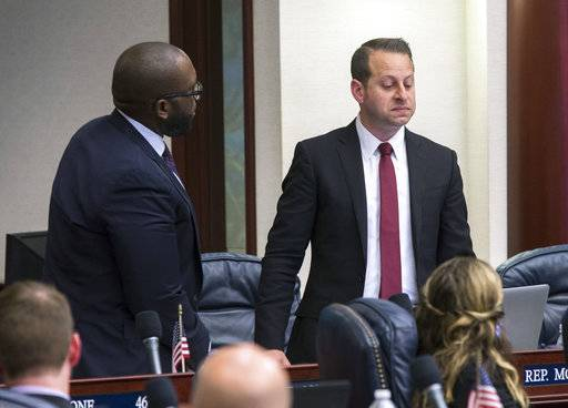 Florida Rep. Jared Moskowitz, right, D-Coral Springs, regains his composure during his debate of the school safety bill as Rep. Shevrin D. Jones, D-West Park, looks on just prior to the vote at the Florida Capital in Tallahassee, Fla., Wednesday March 7, 2018.