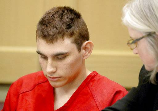 FILE - In this Feb. 19, 2018 file photo, Nikolas Cruz, accused of murdering 17 people in the Florida high school shooting, appears in court for a status hearing in Fort Lauderdale, Fla. Cruz was formally charged Wednesday, March 7, with 17 counts of first-degree murder, which could mean a death sentence if he is convicted. (Mike Stocker/South Florida Sun-Sentinel via AP, Pool, File)