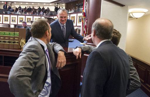 Florida Speaker of the House Rep. Richard Corcoran (R-Lutz) speaks with Representatives and Senators at the dais during the school safety debate on the House floor at the Florida Capital in Tallahassee, Fla., Wednesday March 7, 2018.