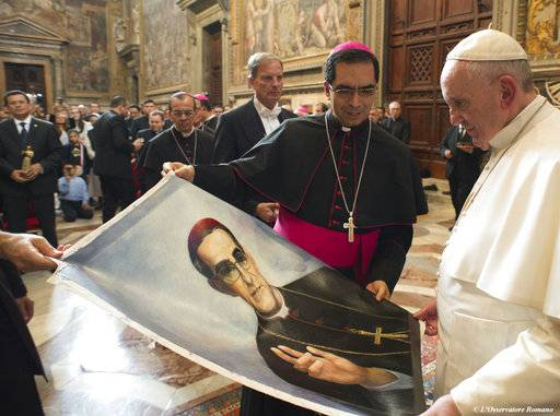 FILE -- In this Oct. 30, 2015 file photo, Pope Francis is presented with an image of Roman Catholic Archbishop Oscar Romero during a private audience granted to participants to the pilgrimage from El Salvador at the Vatican. Pope Francis has cleared the way for slain Salvadoran Archbishop Oscar Romero to be made a saint, declaring that a churchman who stood up for the poorest of the poor in the face of right-wing oppression should be a model for Catholics today. (L'Osservatore Romano/Pool Photo via AP)