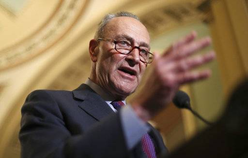 "In this March 6, 2018, photo, Senate Minority Leader Chuck Schumer of N.Y., speaks with reporters following weekly policy luncheons on Capitol Hill in Washington. Senate Democrats have a plan to reverse some of the tax breaks and put the money instead toward a $1 trillion infrastructure package. The proposal is more campaign theme than actual legislative agenda, since Republicans hold the majority in Congress. ""The bottom line is very simple,� Schumer told The Associated Press. ""The vast majority of Americans would much prefer new, 21st century infrastructure than tax breaks for the wealthiest of people.�"
