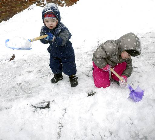 Two-year-old Kalogero Drum, left, tries to carry a shovel full of snow as he and his sister Karizma, 4, have fun playing in the snow near their West 4th Street home in Hazleton Pa., Wednesday, March 7, 2018 during a snow storm that dumped several inches of snow throughout the area.(Ellen F. O'Connell/Hazleton Standard-Speaker via AP)(Ellen F. O'Connell/Hazleton Standard-Speaker via AP)