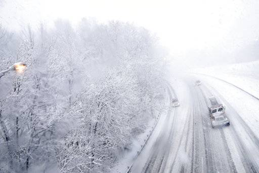 Vehicles travel northbound over a snow-covered Interstate 287 during a snowstorm, Wednesday, March 7, 2018, in Morristown, N.J.