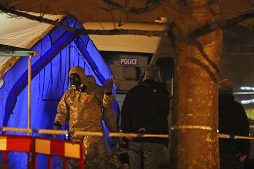 "Investigators next to a police tent outside The Mill public house at the Maltings in Salisbury, England, Tuesday, March 6, 2018, near to where former Russian double agent Sergei Skripal was found critically ill.  Britain's counterterrorism police took over an investigation Tuesday into the mysterious collapse of a former spy and his daughter, now fighting for their lives. The government pledged a ""robust"" response if suspicions of Russian state involvement are proven. Sergei Skripal and his daughter are in a critical condition after collapsing in the English city of Salisbury on Sunday. (Steve Parsons/PA via AP)"