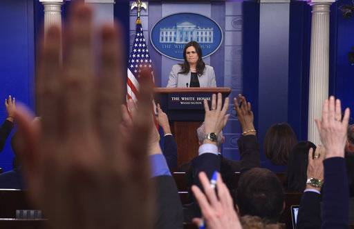 White House press secretary Sarah Huckabee Sanders listens to a reporter's question during the daily briefing at the White House in Washington, Wednesday, March 7, 2018.
