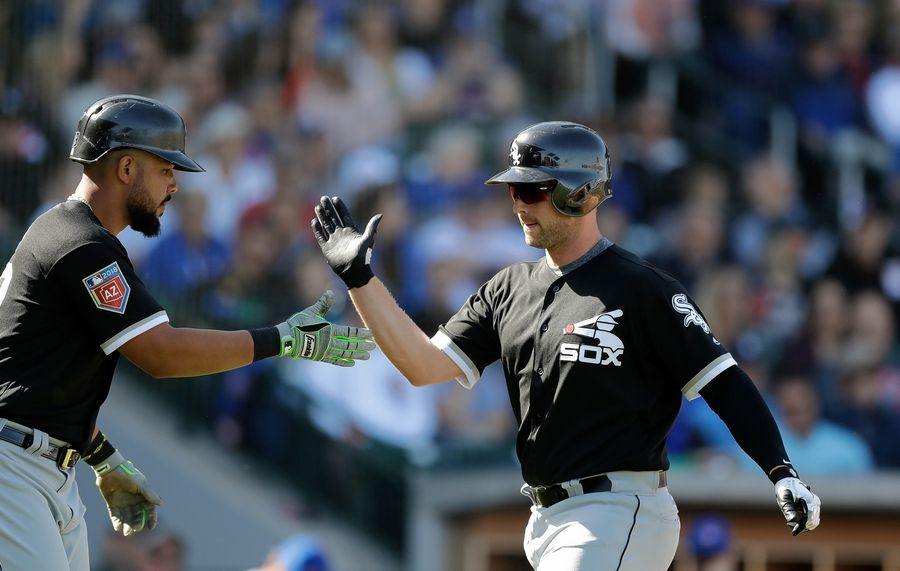 Matt Davidson of the Chicago White Sox is greeted after hitting a two-run home run in a spring training game against the Cubs. Davidson hit 26 homers for the White Sox last season.