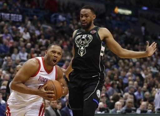 Houston Rockets' Eric Gordon drives past Milwaukee Bucks' Jabari Parker during the first half of an NBA basketball game Wednesday, March 7, 2018, in Milwaukee.