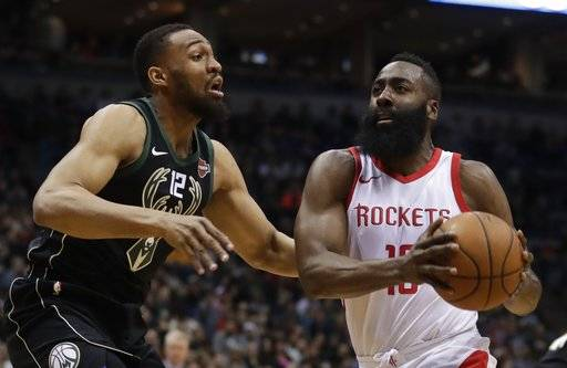 Houston Rockets' James Harden drives past Milwaukee Bucks' Jabari Parker during the first half of an NBA basketball game Wednesday, March 7, 2018, in Milwaukee.