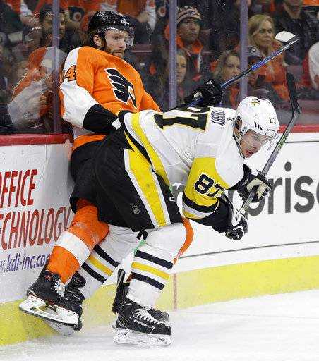 Pittsburgh Penguins' Sidney Crosby (87) collides with Philadelphia Flyers' Sean Couturier (14) during the third period of an NHL hockey game, Wednesday, March 7, 2018, in Philadelphia. Pittsburgh won 5-2.