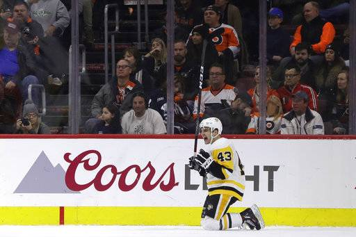 Pittsburgh Penguins' Conor Sheary celebrates after a goal during the second period of an NHL hockey game against the Philadelphia Flyers, Wednesday, March 7, 2018, in Philadelphia.