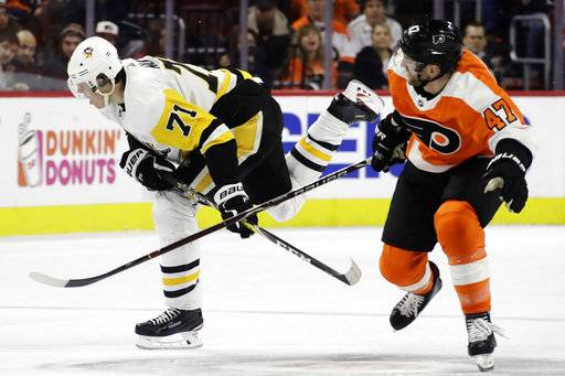 Pittsburgh Penguins' Evgeni Malkin, left, and Philadelphia Flyers' Andrew MacDonald collide during the first period of an NHL hockey game, Wednesday, March 7, 2018, in Philadelphia.