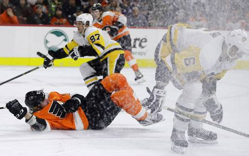 Philadelphia Flyers' Jakub Voracek (93) is sent flying after colliding with Pittsburgh Penguins' Jamie Oleksiak (6) during the second period of an NHL hockey game, Wednesday, March 7, 2018, in Philadelphia.