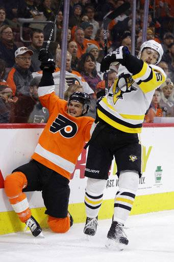 Pittsburgh Penguins' Riley Sheahan, right, and Philadelphia Flyers' Scott Laughton collide during the second period of an NHL hockey game, Wednesday, March 7, 2018, in Philadelphia.