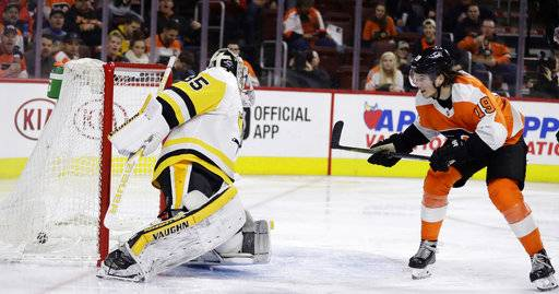 Philadelphia Flyers' Nolan Patrick, right, scores a goal past Pittsburgh Penguins' Tristan Jarry during the second period of an NHL hockey game, Wednesday, March 7, 2018, in Philadelphia.