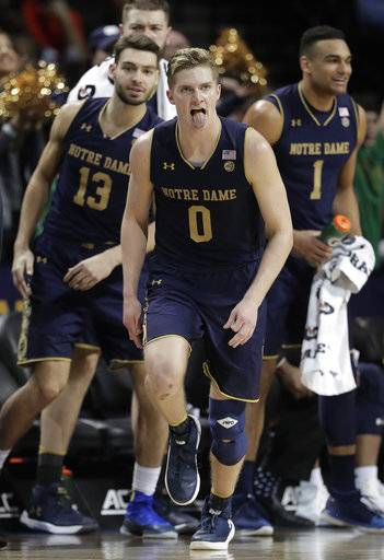 Notre Dame guard Rex Pflueger (0) reacts after hitting a 3-point shot against Virginia Tech during the second half of an NCAA college basketball game in the second round of the Atlantic Coast Conference men's tournament Wednesday, March 7, 2018, in New York. Notre Dame won 71-65.