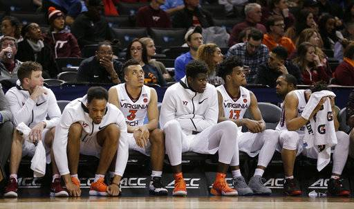 Virginia Tech players watch from the bench in the closing minute of an NCAA college basketball game against Notre Dame during the second round of the Atlantic Coast Conference men's tournament Wednesday, March 7, 2018, in New York. Notre Dame won 71-65.