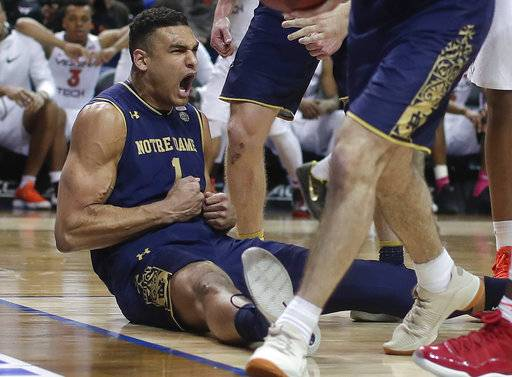 Notre Dame forward Austin Torres (1) reacts after drawing an offensive foul on Virginia Tech during the second half of an NCAA college basketball game in the second round of the Atlantic Coast Conference men's tournament Wednesday, March 7, 2018, in New York. Notre Dame won 71-65.
