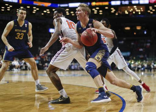 Notre Dame guard Rex Pflueger drives around Virginia Tech guard Justin Bibbs (10) during the first half of an NCAA college basketball game in the second round of the Atlantic Coast Conference men's tournament Wednesday, March 7, 2018, in New York.