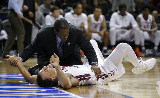 Virginia Tech guard Justin Robinson (5) is helped by a trainer after falling to the floor during the second half of the team's NCAA college basketball game against Notre Dame in the second round of the Atlantic Coast Conference men's tournament Wednesday, March 7, 2018, in New York. Notre Dame won 71-65.