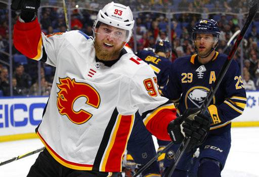 Calgary Flames forward Sam Bennett (93) celebrates his goal during the first period of an NHL hockey game against the Buffalo Sabres, Wednesday, March. 7, 2018, in Buffalo, N.Y.