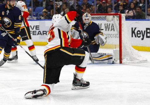 Calgary Flames forward Sean Monahan (23) shoots the puck past Buffalo Sabres goalie Chad Johnson (31) during the second period of an NHL hockey game, Wednesday, March. 7, 2018, in Buffalo, N.Y.