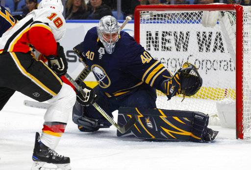 Buffalo Sabres goalie Robin Lehner (40) stops Calgary Flames forward Matt Stajan (18) during the second period of an NHL hockey game, Wednesday, March. 7, 2018, in Buffalo, N.Y.