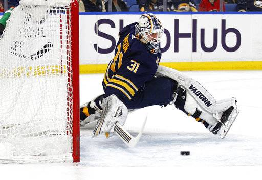 Buffalo Sabres goalie Chad Johnson (31) makes a save during the first period of an NHL hockey game against the Calgary Flames, Wednesday, March. 7, 2018, in Buffalo, N.Y.