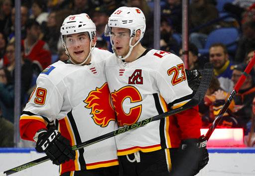 Calgary Flames forwards Micheal Ferland (79) and Sean Monahan (23) celebrate a goal during the second period of an NHL hockey game against the Buffalo Sabres, Wednesday, March. 7, 2018, in Buffalo, N.Y.