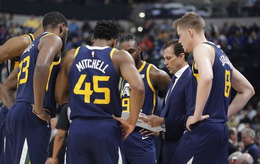 Utah Jazz coach Quin Snyder talks to his team during the first half of an NBA basketball game against the Indiana Pacers, Wednesday, March 7, 2018, in Indianapolis.