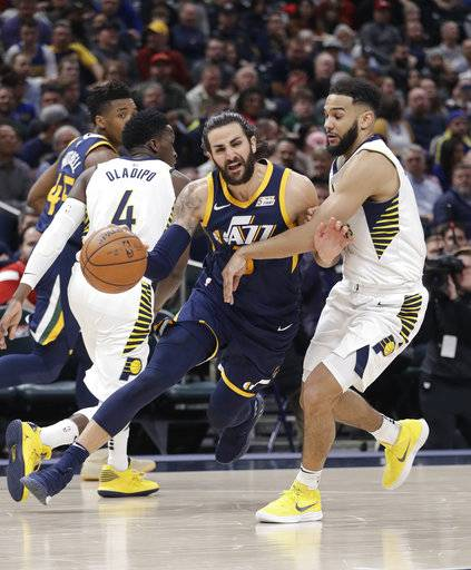 Utah Jazz's Ricky Rubio goes to the basket against Indiana Pacers' Cory Joseph during the second half of an NBA basketball game Wednesday, March 7, 2018, in Indianapolis. Utah won 104-84.