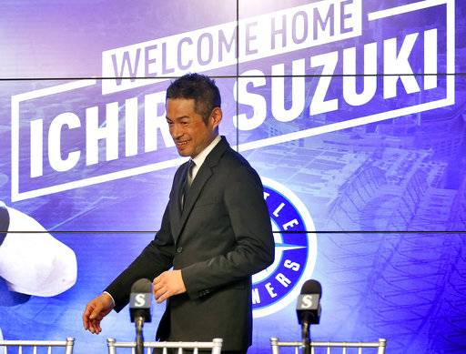 Seattle Mariners' Ichiro Suzuki arrives after signing a contract to a news conference at the teams' spring training baseball complex Wednesday, March 7, 2018, in Peoria, Ariz. Suzuki signed a one year deal in his return to the Mariners.