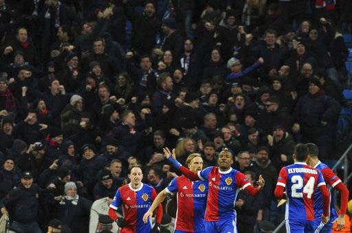 Basel's Michael Lang, second from left, celebrates with his teammates after scoring his side's second goal during the Champions League, round of 16, second leg soccer match between Manchester City and Basel at the Etihad Stadium in Manchester, England, Wednesday, March 7, 2018.