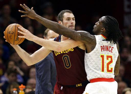 FILE - In this Nov. 5, 2017, file photo, Cleveland Cavaliers' Kevin Love (0) looks to pass against Atlanta Hawks' Taurean Prince (12) in the first half of an NBA basketball game in Cleveland. Love disclosed in an essay for the Players' Tribune on Tuesday, March 6, 2018, that he suffered a panic attack on Nov. 5 in a home game against the Hawks. He was briefly hospitalized at the Cleveland Clinic and the episode left him shaken.