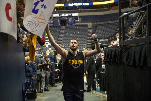 FILE - In this Feb. 23, 2018, file photo, Cleveland Cavaliers forward Kevin Love greets fans before an NBA basketball game against the Memphis Grizzlies, in Memphis, Tenn. The All-Star forward, who has been sidelined since late January with a broken left hand, said Friday, March 2, 2018,  that he's progressing well and it's possible he could return sooner than expected. Love has been out since Jan. 29 and was expected to miss two months.