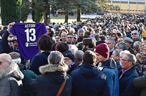 People line up to pay their tribute to Italian player Davide Astori at the Coverciano Sports Center, near Florence, Italy, Wednesday, March 7, 2018. The 31-year-old Astori was found dead in his hotel room on Sunday after a suspected cardiac arrest before his team was set to play an Italian league match at Udinese. (Maurizio Degl'Innocenti/ANSA via AP)