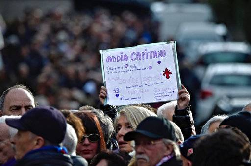 "A supporter holds up a sign reading ""Goodbye Captain"" as people line up to pay their tribute to Italian player Davide Astori at the Coverciano Sports Center, near Florence, Italy, Wednesday, March 7, 2018. The 31-year-old Astori was found dead in his hotel room on Sunday after a suspected cardiac arrest before his team was set to play an Italian league match at Udinese. (Maurizio Degl'Innocenti/ANSA via AP)"