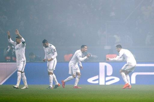 Real Madrid's Cristiano Ronaldo, right, celebrates with his teammates after scoring the opening goal of his team during the round of 16, 2nd leg Champions League soccer match between Paris Saint-Germain and Real Madrid at the Parc des Princes Stadium in Paris, Tuesday, March 6, 2018.
