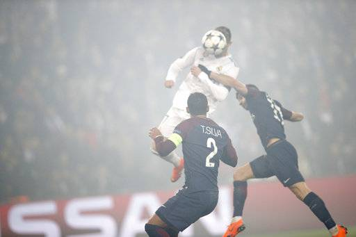 Real Madrid's Cristiano Ronaldo heads the ball to score his side's first goal during the Champions League round of sixteen second leg soccer match between Paris St. Germain and Real Madrid at the Parc des Princes stadium in Paris, France, Tuesday, March 6, 2018.