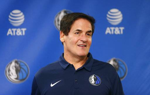 FILE - In this Monday, Feb. 26, 2018, file photo, Dallas Mavericks owner Mark Cuban stands on stage before a news conference in Dallas. Cuban is denying a 2011 allegation of sexual assault after a weekly alternative newspaper in Oregon published details of a case that prosecutors didn't pursue, saying they didn't believe there was evidence to support the claim.
