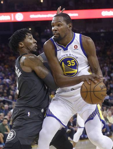 Golden State Warriors forward Kevin Durant (35) drives against Brooklyn Nets forward Rondae Hollis-Jefferson during the first half of an NBA basketball game in Oakland, Calif., Tuesday, March 6, 2018.